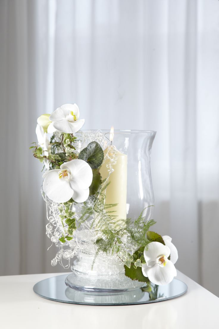 Clear glass hurricane vase teamed with oasis mini deco s
