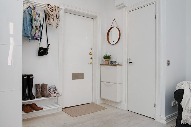 Clever use of a small space in Sweden: One fine example of doubling up on space is the IKEA shoe storage unit by the door which also works as a shelf to place keys, a plant etc. I've got my eye on this for my own home.