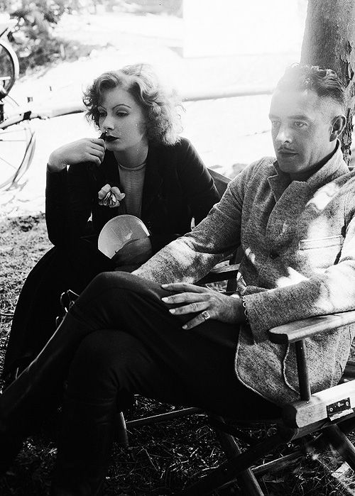 Greta Garbo and John Gilbert taking a break on the set of Love - 1927.