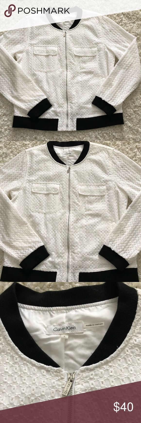 Calvin Klein Bomber Jacket Calvin Klein bomber jacket  Crochet detail all over jacket  Black trim on neckline and bottom of jacket  Size large  Like new condition  Shell is 53% cotton 47% polyester  Lining is 100% polyester Calvin Klein Jackets & Coats Utility Jackets