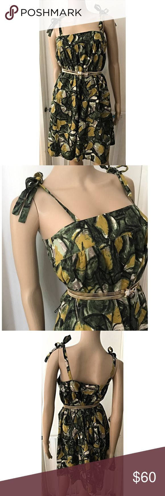 """NWT Anthro Fei Vintage Leaves Fruit Dress Gorgeous vintage inspired print dress from Anthropologie Fei in size 4 It's more Oversized style so, probably can fit a small to large size person. No flaws. Features leaves, lemon/pears looking prints, with adjustable thin straps on the shoulder that can be tied different ways, functional pockets on the bottom. Had belt loop but comes as is. Belt is not included. Measure about 25"""" length w/out straps, 16.5"""" pit to put, waist and hips are free.❌No…"""