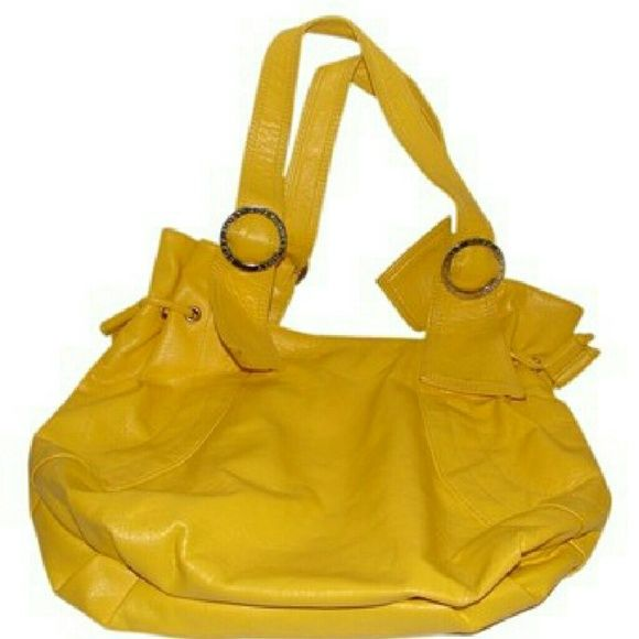 Roxy Orange Coast bag in yellow Logo embossed hardware accents is super bright faux leather bag was slightly slouchy shape and adjustable drawstrings at the sides. Interior top snap closure. Bag fits under arm. Strap drop 10 inches. There is some spots on one side as shown in picture I have not tried to clean. Otherwise bag is in great used condition Roxy Bags Shoulder Bags