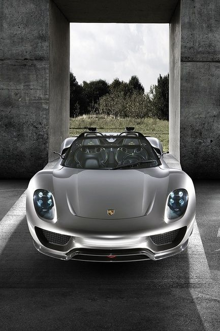 Porsche 918 Spyder! Electric motor in the front and a V8 in the back. 800hp and gets ridiculously good gas mileage!