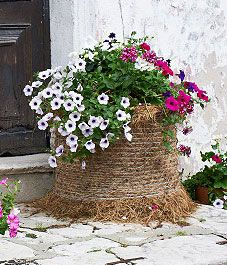 straw bale gardening - for height in the garden. I am growing my potatoes in something similar this year :)