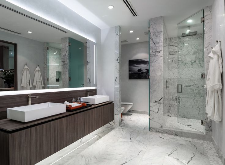Modern Master Bathroom With Wall Sconce, Rain Shower, Complex Marble Tile  Floors, Flush
