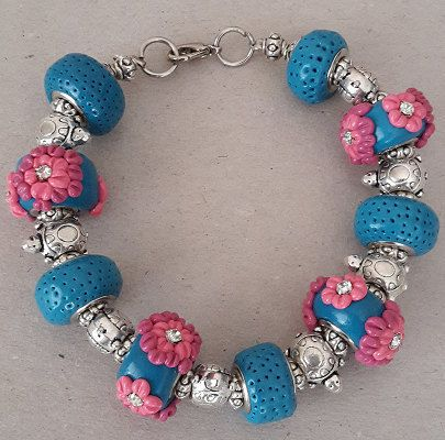 Check out this item in my Etsy shop https://www.etsy.com/listing/236961394/turquoise-and-pink-polymer-clay-bracelet