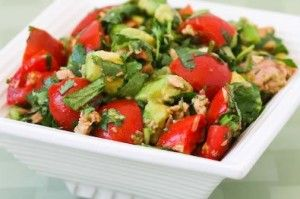 1 can of tuna (120)     balsamic vinegar (0)     1/2 tomato (15)     1/2 medium avocado (110)    Nutrition: 245 calories, 27g protein