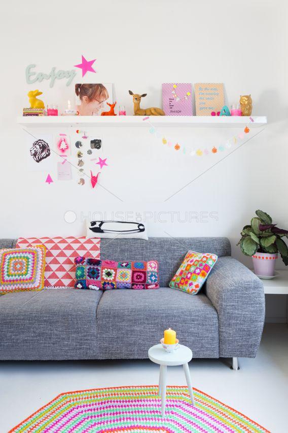 grey sofa + pink accents