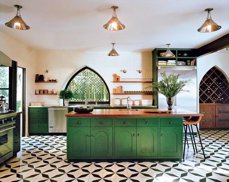 From the Moorish details in the architecture, to the rich green cabinets to the graphic handpainted tiled floor, this glamorous kitchen has all the right stuff. If you like the tile, try our Palmera or Jardin Fretwork.