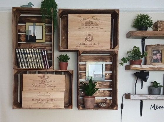 Old fruit boxes as a shelf. That would fit very well in our