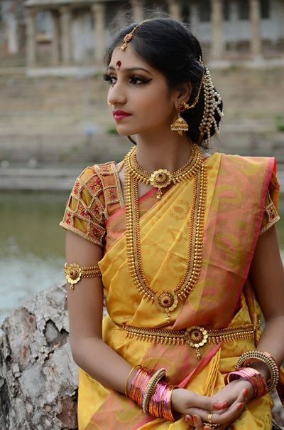 Bride in a Mustard and Peach Silk Saree