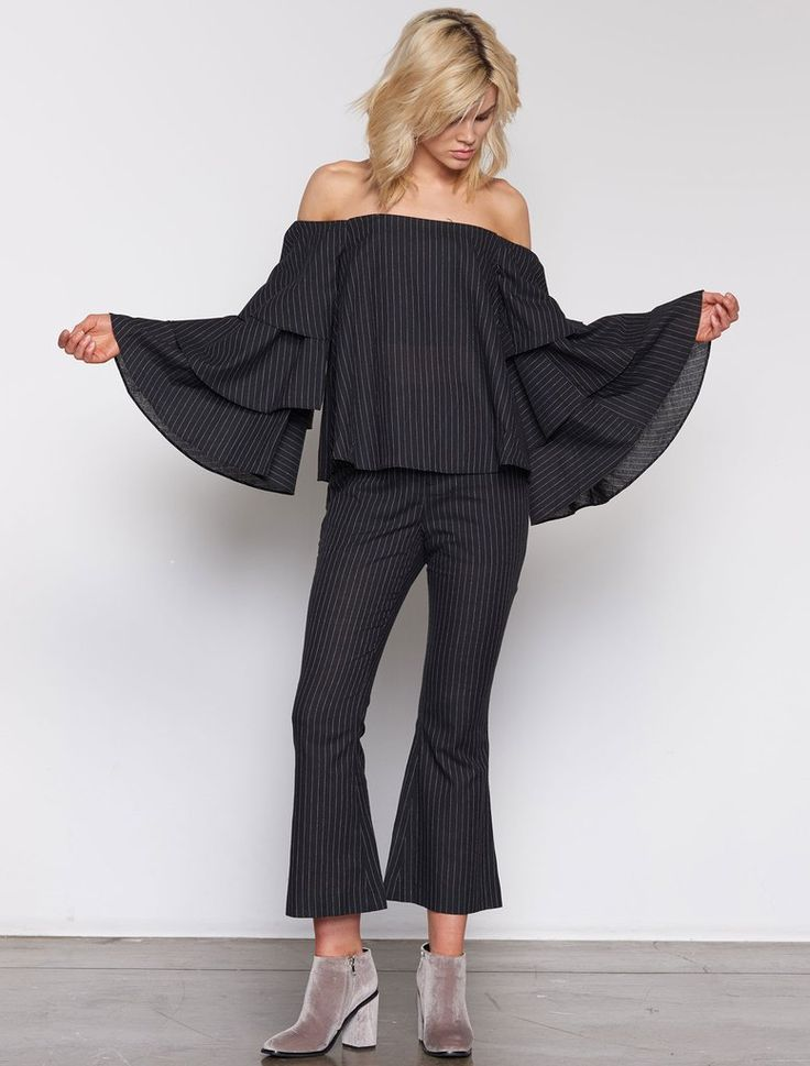 ISLA PERPETUAL OFF SHOULDER TOP. Too much drama in your life? Then channel it into your sleeves. The Perpetual is a pin-stripe, strapless off the shoulder top, with triple ruffle flared sleeves, cropping on the hip. Available www.islalabel.com