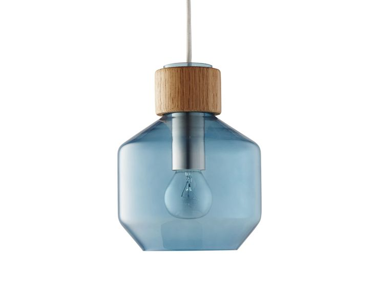 """"""" The Vetro lamp range is designed by Rikke Frost, who wanted to explore the contrasts between wood and stained glass; a combination which we think is both beautiful and interesting. Vetro lamps are available in several different varieties of coloured glass and wood - so you can choose exactly which one suits your home best."""