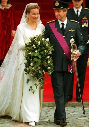 DECEMBER 1999 – Crown Prince Philippe of Belgium marries Princess Mathilde in Brussels.Mathilde was young and pretty, came from a good background (she was a jonkvrouw, a lower grade of nobility, at the time and her father was made a count), she had an honorable career, and she possessed enough warmth and charisma to spill some over to her stiff husband. Plus, she was actually born in Belgium (a rarity - she'll be the first-ever Belgian-born queen consort). She was a hit.