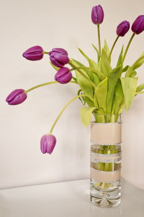 Spray Paint and Rhinestone Vase Centerpiece - a great DIY idea to add flowers to your decor or for weddings!