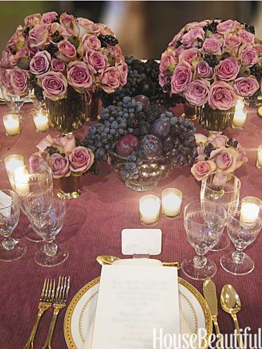 Fall Produce mixed bowls of plums and black grapes with arrangements of Amnesia roses, figs, and berries.