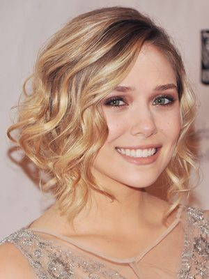 Elizabeth Olsen's faux bob with almost carefree curls is my favorite look to try to recreate. Yet at the same time it's the hardest for me to like on myself. Her natural face is enhanced with makeup not covered up like most.