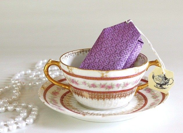 "DIY Tea Party Favors      Who doesn't love a tea party with all of it's lady-like charm and dainty accouterments. And of course it's the little details that set any party apart from the rest, and these DIY tea bag favors are one of my favorite projects which does just that!    I made these ""tea bags"" to hold tea cookies and double as place card holders in the tea party I styled for Hens and Chicks Parties ""party in a box"" set. All you need is some scrapbook paper and ba"