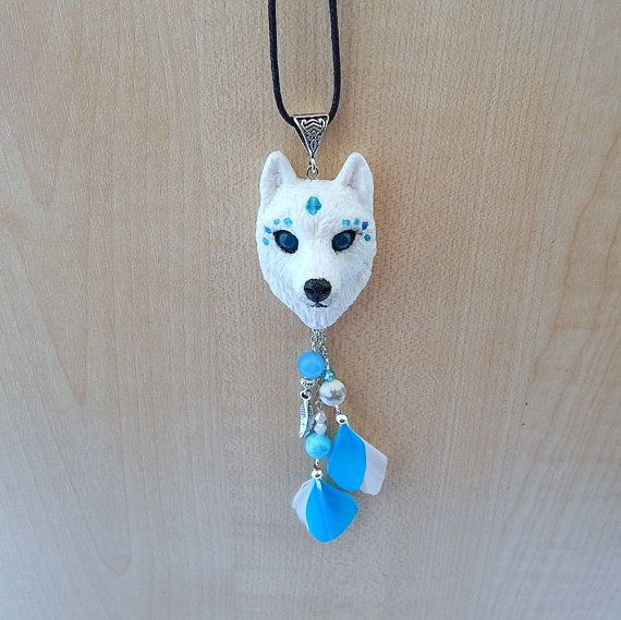Wolf head pendant I made of polymer clay, chains, real feather and blue aventurine, waxed cord. The diameter of the pendant is 5 cm, length pendant