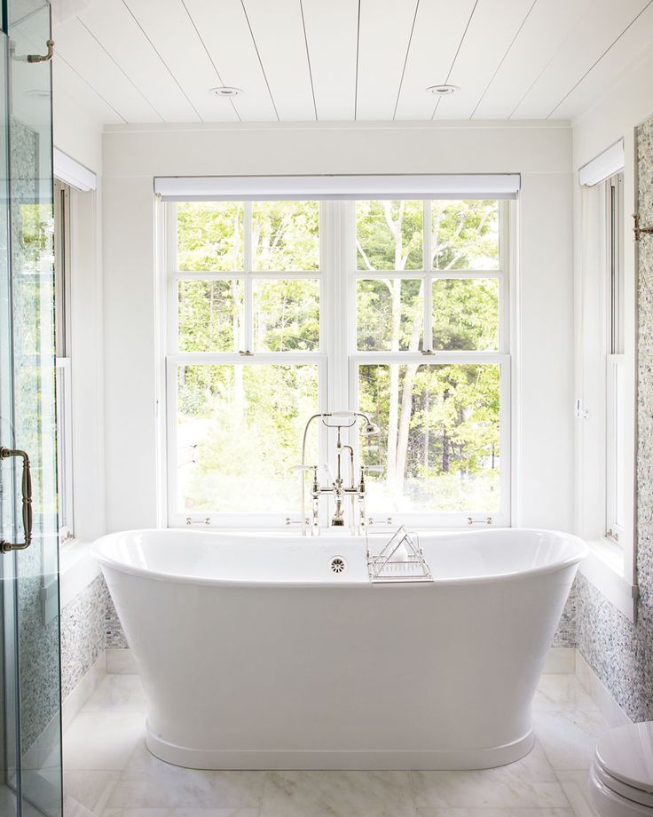 Centre a free-standing tub in front of a picture window Indulge in the peace and serenity that a country property provides with your own spa. A stand-alone bathtub with stunning views and separate shower is the ultimate in luxury.