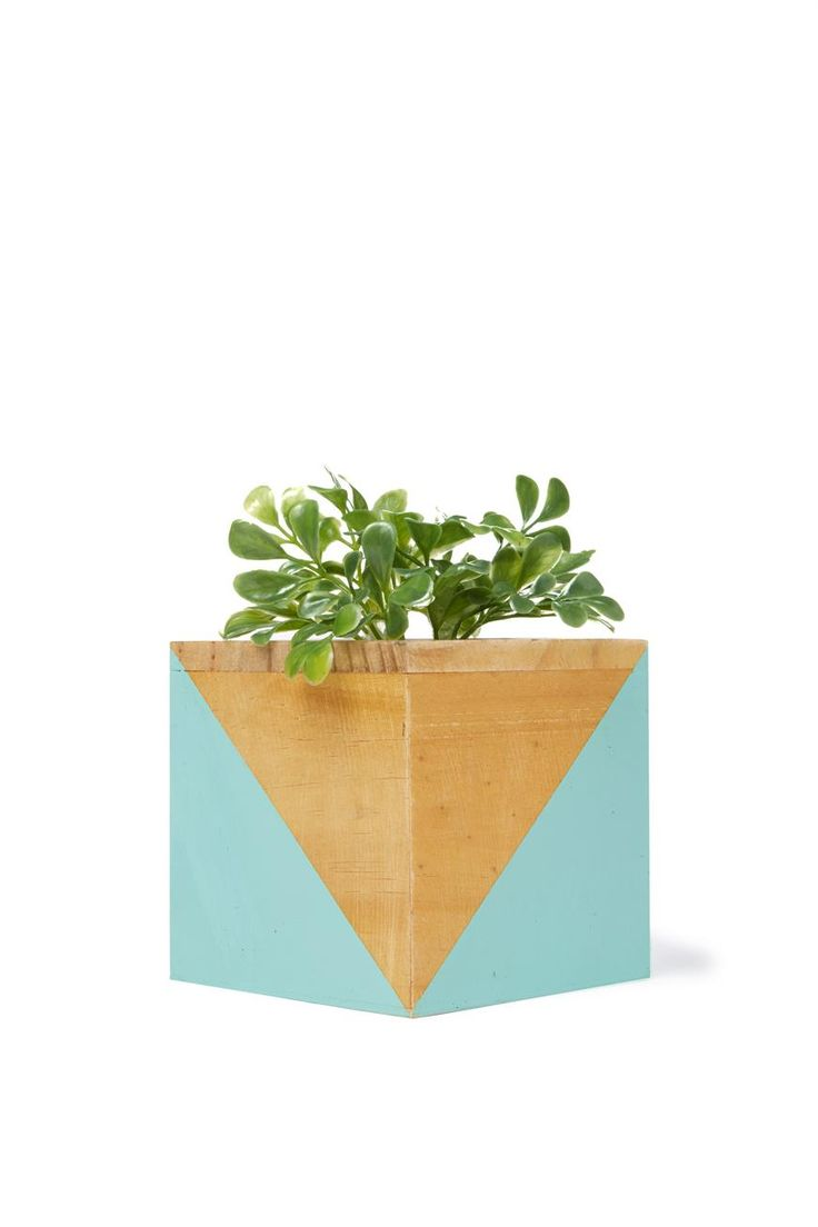 Wooden block planters are perfect to bring a bit of greenery to your desk space! <br> Each planter is made from wood, and includes a fake plant that is removable so you can fill with your fave plant. <br> Dimensions: 13cm H x 13cm W. <br/>