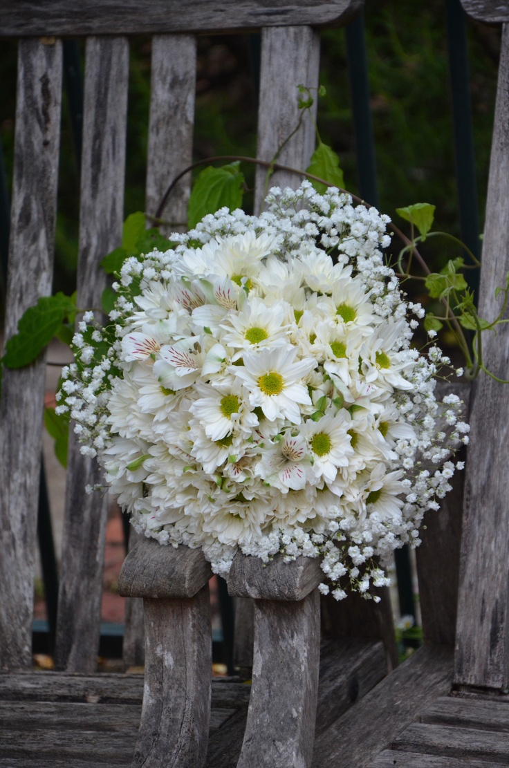 Recipes  White and pale yellow daisy . Babies breath . white peruvian lilies . White silk ribbon and pearl pins