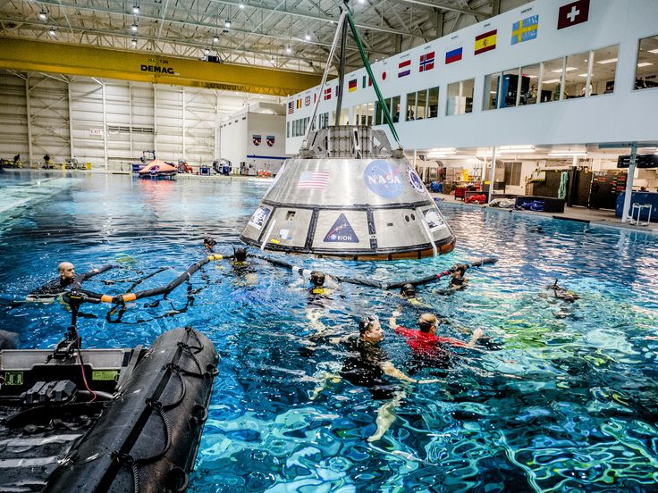 Practicing Orion Spacecraft Recovery After Splashdown A group of U.S. Navy divers Air Force pararescuemen and Coast Guard rescue swimmers practice Orion underway recovery techniques in the Neutral Buoyancy Laboratory at NASAs Johnson Space Center to prepare for the first test flight of an uncrewed Orion spacecraft with the agencys Space Launch System rocket during Exploration Mission (EM-1).