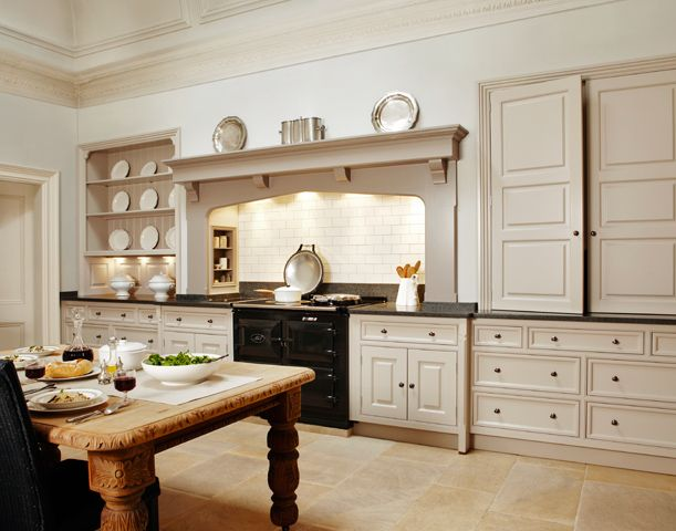 This classic style kitchen has traditional Georgian style doors and drawers set around an impressive chimney.