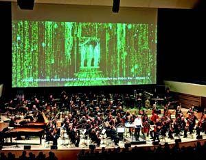 Matrix Live à Lille: L'ONL en « tout numérique » au Nouveau Siècle. L'Orchestre National de Lille jouait en direct la musique de « Matrix » au Nouveau Siècle. Réseau EtherSound reliant les 54 micros numériques à la console DiGiCo et aux amplis et enceintes Nexo, projection vidéo 4K, double système LCR devant/derrière écran, diffusion Surround, mélange d'éléments pré-enregistrés et live : un grand nombre de problèmes à la clé, résolus avec élégance.