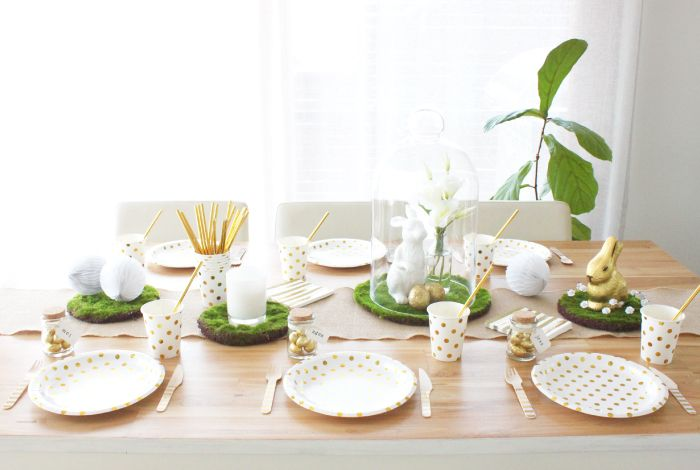 The 'grown up' Easter table with gold foil polkadot paper plates, gold foil paper cups filled with stunning gold foil straws and gold striped wooden cutlery.  All items can be purchased at www.hipandhooray.com.au