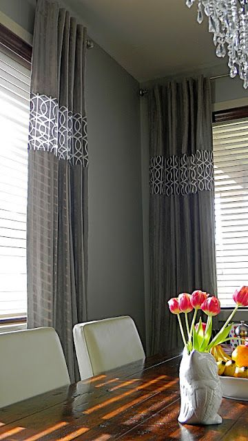 Two fabric curtain panels ~ DIY via The Design Pages ~ Great way to tie two adjoining rooms together with coordinating (but not identical) fabrics
