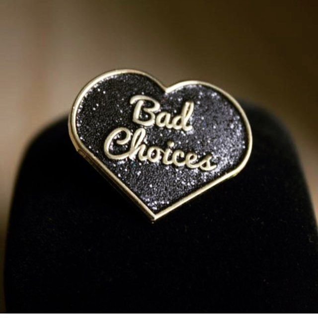 """How's your judgement lately? Yeah me too. """"Bad Choices"""" glitter pin now available in limited quantities- link in bio! 🌑✨💜 . . #pingame #pin #enamelpin #heart #glitter #badchoices #flair #girlpingang #allblackeverything"""