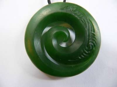 A Maori Koru carved out of greenstone. It is said to represent the opening of the silver fern frond - bringing new life and new beginnings.