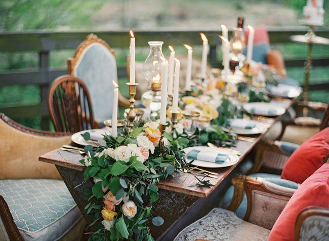 Garland center piece with an eclectic collection of chairs and table ware.