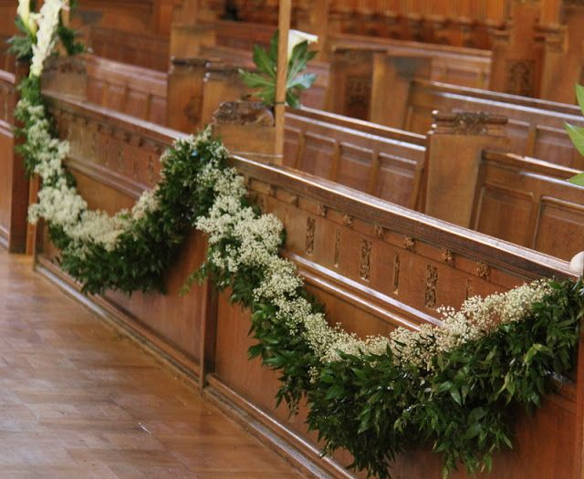 Garlands of Foliage and Gypsophila swagged across the pews