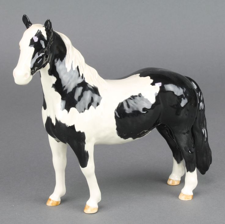 "Lot 17, A Beswick Piebald Pinto pony no.1373, gloss finish, 7"" est £50-75"