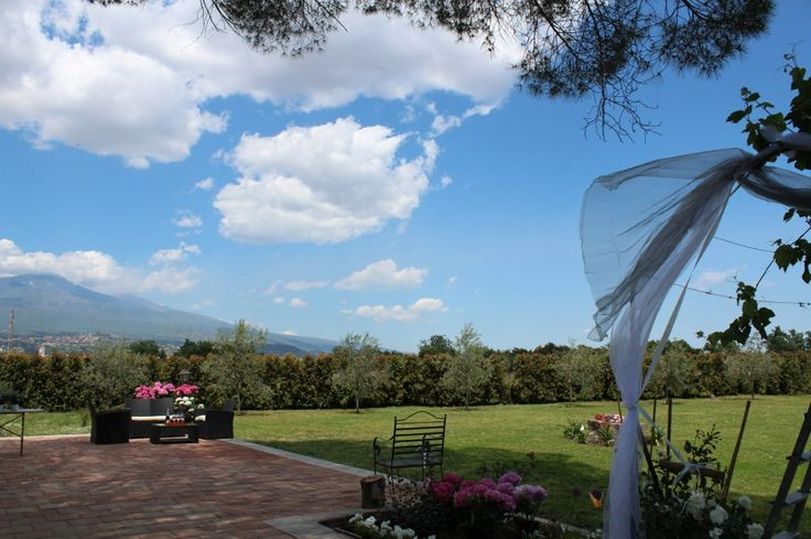 Petralonga- Giardino dell'Etna, Large green garden decorated with a breathtaking view to Mount Etna.