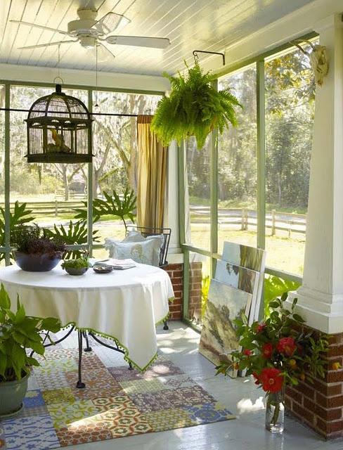 Screened in front porch with bird-cage and fern or also back porch, would love that at the new house  d.