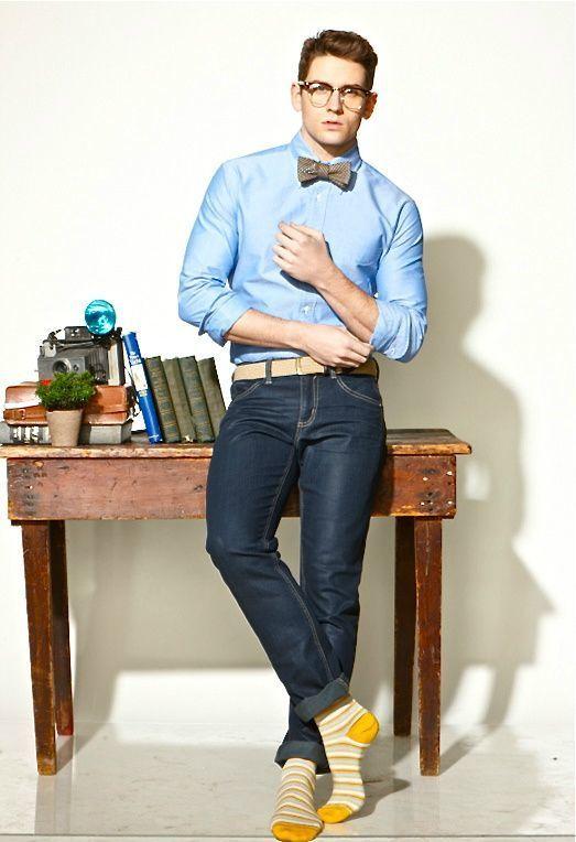 Shop this look on Lookastic:  https://lookastic.com/men/looks/dress-shirt-skinny-jeans-bow-tie-belt-socks/13075  — Light Blue Dress Shirt  — Brown Check Bow-tie  — Beige Leather Belt  — Navy Skinny Jeans  — Yellow Horizontal Striped Socks