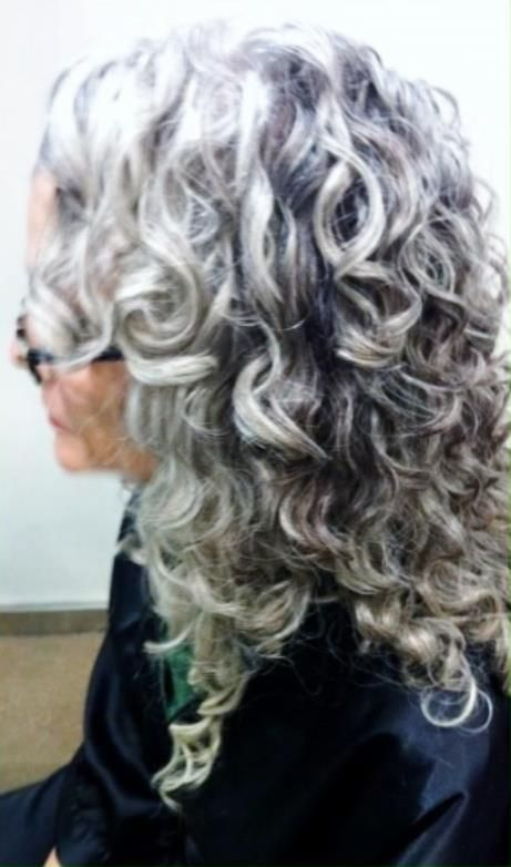 Long curly gray hair. I hope my hair stays curly when it gets gray.