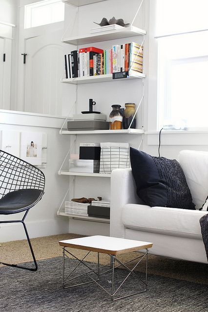 Colours and decor ideal for the new loft, white greys and wood with a pop of colour see board. courtesy of 'my living room by AMM blog'