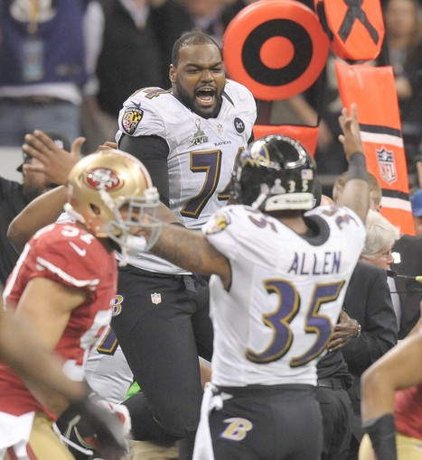 Michael Oher  ( Baltimore Sun photo by Gene Sweeney Jr. / February 3, 2013 )  Michael Oher celebrates the Ravens' Super Bowl victory.