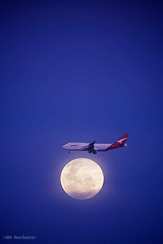 Qantas 747 photo by oneshuteye - Australia    We'll be landing on the moon momentarily.