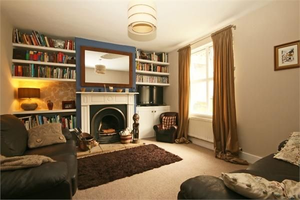Love the alcoves either side of the chimney breast with display shelf on the left and book shelves above.