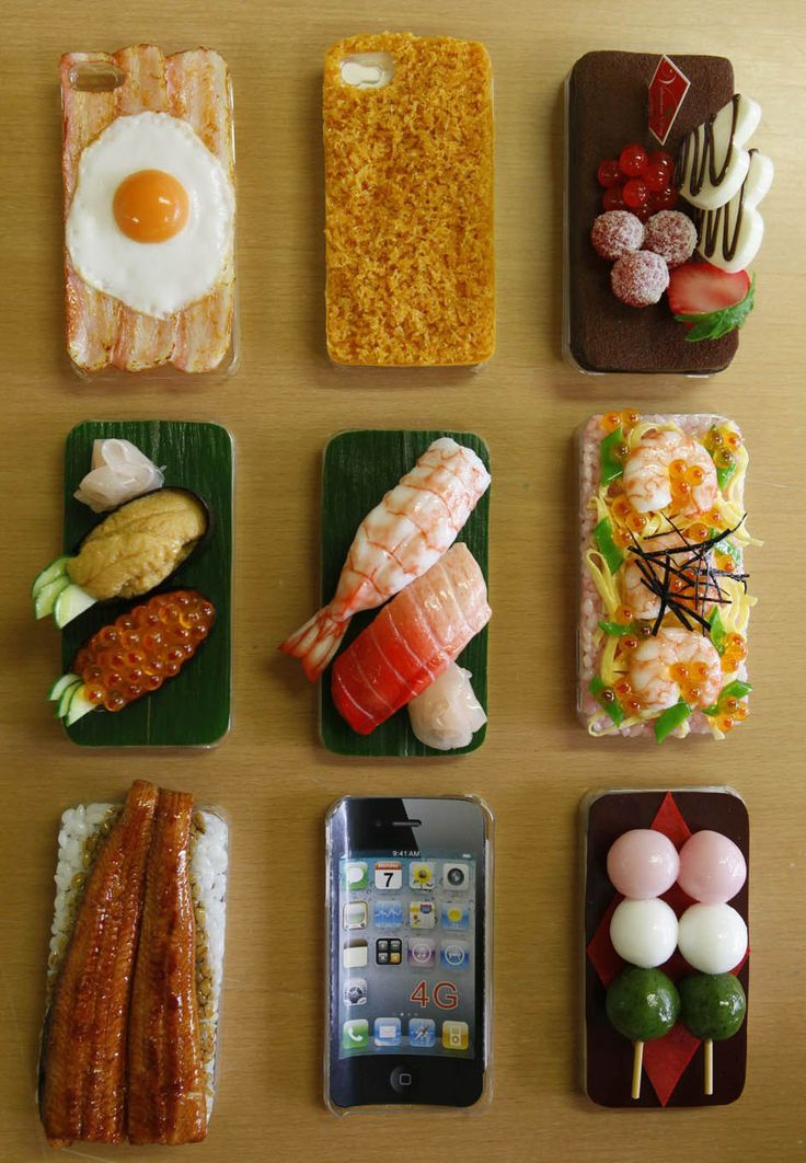 iPhone cases decorated with plastic models of food are displayed during a photo opportunity at Suetake Sample, a plastic food model maker, in Yokohama, near Tokyo July 29, 2011.