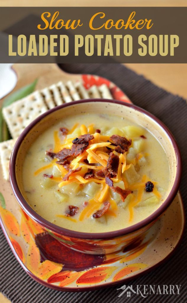 Loaded Potato Soup in a Slow Cooker _ A creamy comfort food loaded with ham, bacon, cheese and lots of potatoes. You can easily make this yummy soup in your crockpot or slow cooker!