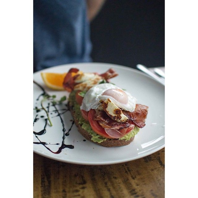 Rye sourdough, smashed avocado, bacon, tom, haloumi & egg @ 644 King St South End, Newtown