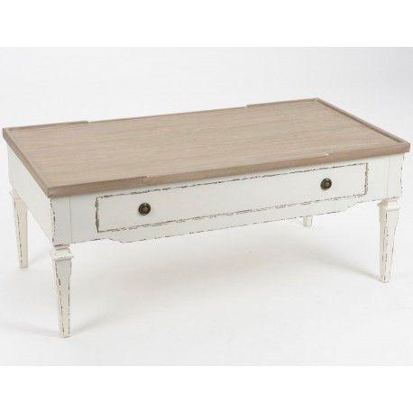 Szeroki stolik kawowy, który został umieszczony na niskich lekko kwadratowych nóżkach, posiadający pojemną szufladkę, dzięki której można pochować np. Podkładki na stół itp.