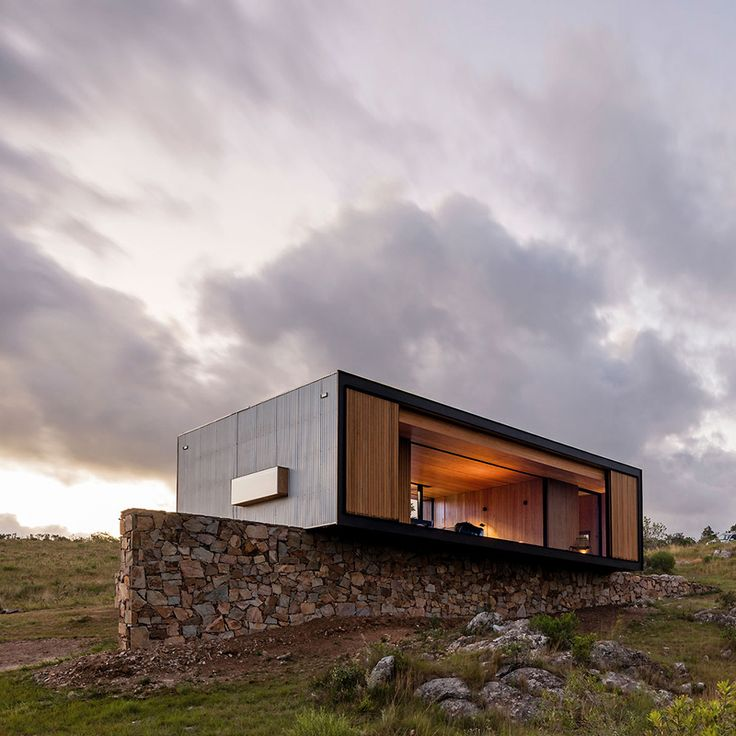 This compact house was prefabricated in a factory near Montevideo, before being…