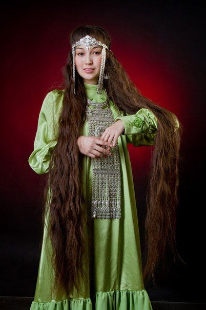 Long braid - a symbol of beauty. woman in yakutian clothes